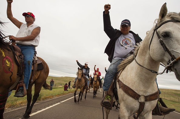 Native Americans ride last week to a sacred burial ground that was disturbed by bulldozers building the Dakota Access Pipeline (DAPL). Hundreds of people have gathered to join the Standing Rock Sioux Tribe's protest of the oil pipeline near Cannon Ball, North Dakota.