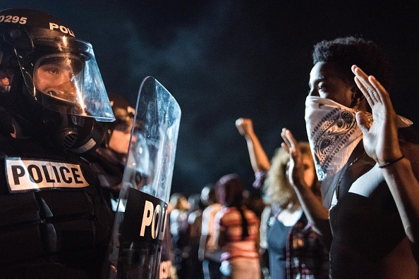 Police officers face off with protesters on Interstate 85 during protests in the early hours of September 21 in Charlotte, North Carolina.