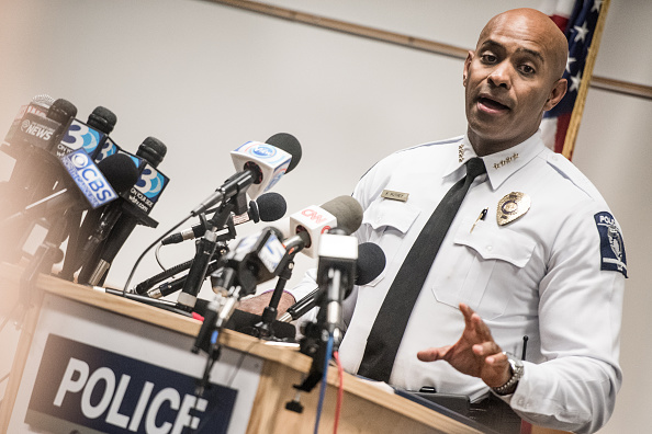 Kerr Putney, chief of the Charlotte-Mecklenburg police, talks with the media concerning the release of police video from a recent officer involved fatal shooting at the Charlotte Police Department West Service Center September 24 in Charlotte, North Carolina.