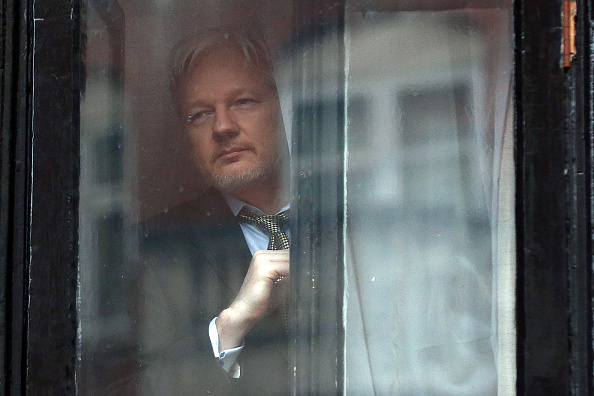 LONDON, ENGLAND - FEBRUARY 05:  Wikileaks founder Julian Assange prepares to speak from the balcony of the Ecuadorian embassy where  he continues to seek asylum following an extradition request from Sweden in 2012, on February 5, 2016 in London, England.