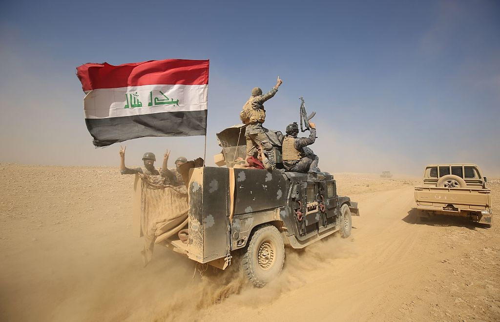 Iraqi forces deploy in the Bajwaniyah village, about 30 kms south of Mosul, on October 18, 2016 after they liberated it from Islamic State (IS) group jihadists.