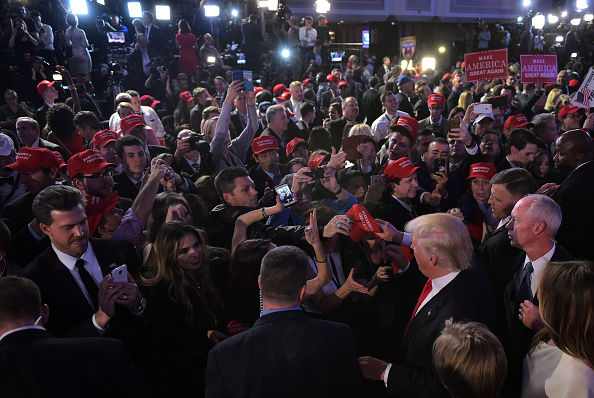 Republican presidential elect Donald Trump meets supporters on November 9, 2016. Trump stunned America and the world Wednesday, riding a wave of populist resentment to defeat Hillary Clinton in the race to become the 45th president of the United States.
