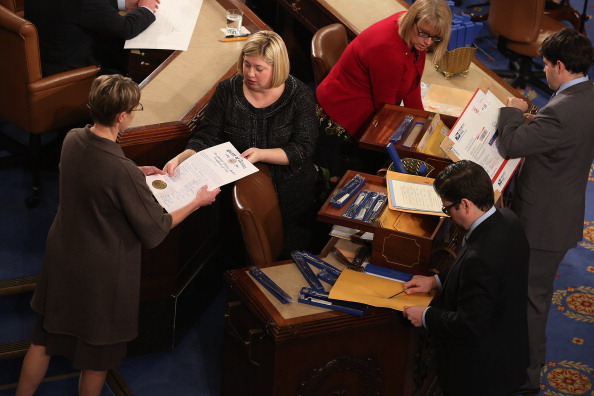 Congressional clerks help unseal and organize the Electoral College votes from the 50 states at the U.S. House of Representatives on January 4, 2013. The votes were tallied during a joint session of the 113th Congress. President Barack Obama and Biden received 332 votes to be reelected.