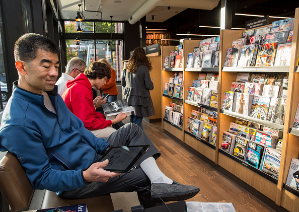 Jeff Ing of Seattle uses a Kindle Fire tablet device at the newly opened Amazon Books store on November 4, 2015 in Seattle, Washington. The online retailer opened its first brick-and-mortar book store on November 3, 2015.