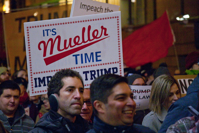 Protesters at Trump Tower in Chicago call for protecting the Mueller investigation against interference by the Trump administration.