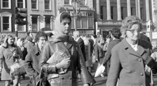 Pedestrians crossing from the top of Talbot Street toward Henry Street in Dublin, Ireland, in 1969.