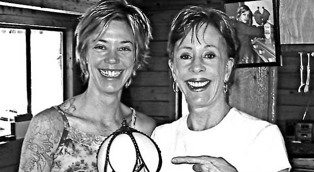 Carol Burnett presenting daughter Carrie with an antique lamp.