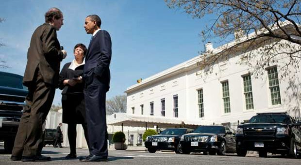 President Barack Obama talks with Cass Sunstein, Office of Information and Regulatory Affairs Administrator, and Senior Advisor Valerie Jarrett on West Executive Avenue between the West Wing of the White House and the Eisenhower Executive Office Building, April 7, 2011.