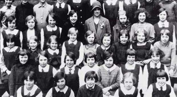 Class photograph of the Junior Class of James Gillespie's Girls' School in 1930. Muriel Spark is second from the right in the third row from the front. The teacher in the middle of the class is Miss Christina Kay, the model for the fictional Miss Jean Brodie.