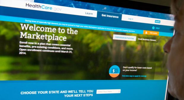 This December 2, 2013 photo shows a woman reading the HealthCare.gov insurance marketplace internet site in Washington, D.C.