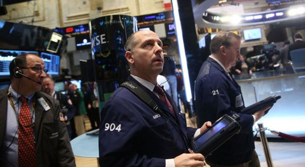 Traders work on the floor of the New York Stock Exchange on January 27, 2014 in New York City. Following a drop of over 300 points on Friday, U.S. markets stabilized in early trading January 27, with the Dow Jones industrial average and the S&P 500 up slightly.