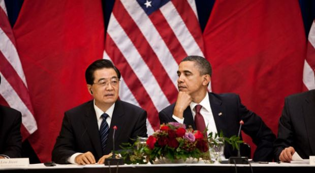 President Barack Obama and President Hu Jintao of China attend a meeting with business leaders in the Eisenhower Executive Office Building of the White House, Jan. 19, 2011.