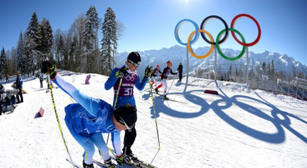 Cross-Country skier Riikka Sarasoja-Lilja of Finland speaks with a coach during training ahead of the Sochi 2014 Winter Olympics at the Laura Cross-Country Ski and Biathlon Center on February 5, 2014 in Sochi, Russia.