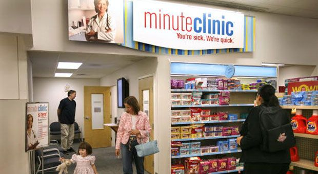 Karen Greisdorf and her daughter Kate, 3, walk out of a MinuteClinic in a CVS store in Bethesda, Maryland, Thursday, September 7, 2006.