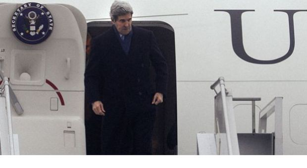 "U.S. Secretary of State John Kerry gestures as he arrives at the International Airport in Kiev on March 4, 2014, for talks with Ukraine's interim government, amid an escalating crisis in Crimea. Washington is likely to take steps on sanctions against Russia ""later in this week,"" a U.S. official travelling with Secretary of State John Kerry to Kiev said on March 4. ""I think there will be movement on sanctions very likely later in this week and there is a whole spectrum of sanctions,"" the official said, speaking on condition of anonymity."
