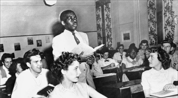 A black student, Nathaniel Steward, 17, recites his lesson surrounded by white fellows and others black students on May 21, 1954 at the Saint-Dominique school in Washington, where for the first time the Brown v Board of Education decision was applied.