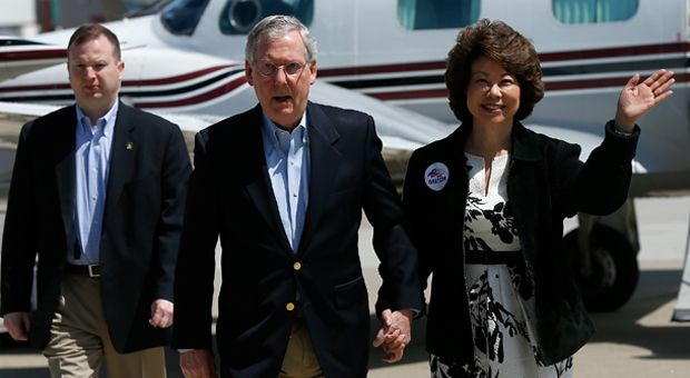 U.S. Senate Republican Leader Sen. Mitch McConnell (R-KY) (C) arrives for a campaign rally with his wife Elaine Chao (R) on May 19, 2014 in Louisville, Kentucky.