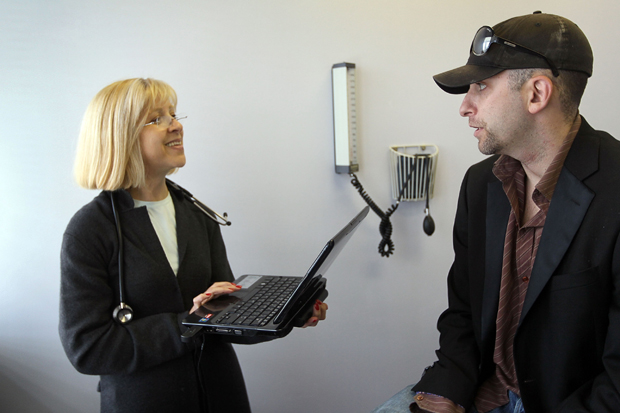 Dr. Klara Gershman uses a laptop computer to enter information about her patient in Miami Beach, Florida.