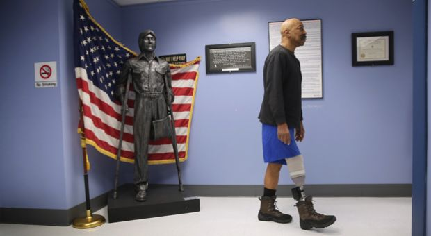 U.S. Military veteran and amputee Lloyd Epps walks after doctors serviced his prosthetic leg at the Veterans Administration (VA) hospital on January 29, 2014 in Manhattan, New York City.