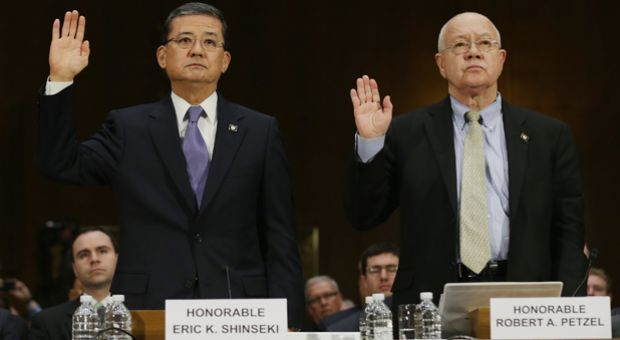 U.S. Veterans Affairs Secretary Eric Shinseki and Veterans Affairs Undersecretary for Health Robert Petzel are sworn in before testifying to the Senate Veterans' Affairs Committee about wait times veterans face to get medical care May 15, 2014 in Washington, DC.