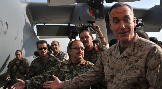 Commander of the International Security Assistance Force (ISAF) in Afghanistan, Joseph Dunford, speaks during the handing over ceremony of two C-130 transport aircraft at Kabul international airport as the US and NATO coalition starts to withdraw.