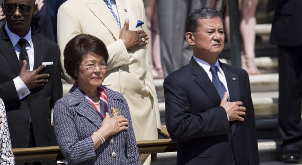 Veterans Affairs Secretary Eric Shinseki (R) and his wife Patricia Shinseki (L) look on during as U.S. President Barack Obama attends a wreath laying ceremony at the Tomb of the Unknown Soldier at Arlington National Cemetery, May 26, 2014 in Arlington, Virginia.