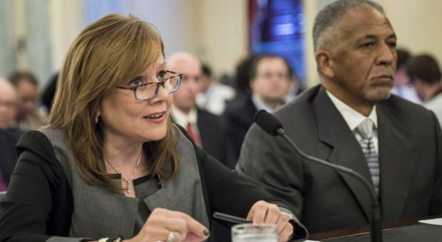Rodney O'Neal (R), Chief Executive Officer and president of Delphi Automotive PLC, listens while Mary Barra, Chief Executive Officer of the General Motors Company, speaks during a hearing of the Senate Commerce, Science and Transportation Committee's Consumer Protection, Product Safety, and Insurance Subcommittee hearing on Capitol Hill July 17, 2014 in Washington, DC.