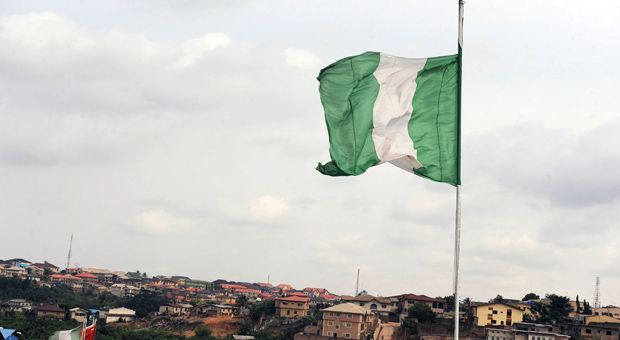 Nigeria's national flag flies above a factory on Ibadan expressway September 8, 2012 in Lagos, Nigeria.