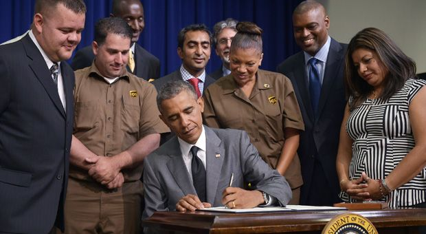 President Barack Obama signs the Fair Pay and Safe Workplace executive order on July 31, 2014 in the South Court Auditorium of the Eisenhower Executive Office Building, next to the White House in Washington, DC.