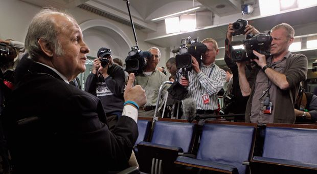Former White House Press Secretary James Brady gives a thumbs-up to members of the news media while visiting the press briefing room that bears his name in the West Wing of the White House March 30, 2011 in Washington, DC. Brady was visiting the White House on the 30th anniversary of the day he was shot in the head by John Hinckley, Jr., during his attempted assassination of former President Ronald Reagan.