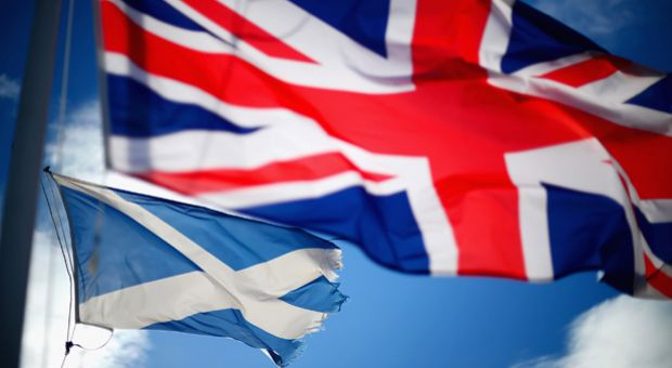 A Union Jack and Saltire flags blow in the wind near to Glen Coe on March 24, 2014 in Glen Coe, Scotland. A referendum on whether Scotland should be an independent country will take place on September 18, 2014.