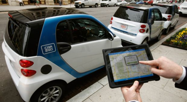 A car2go employee shows how members can use a smartphone or iPad app to locate and reserve car2go vehicles in Washington, DC. In 2012, car2go offered the first free-floating car-sharing service in Washington and Portland, Oregon.