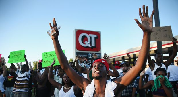 Demonstrators protest the killing of teenager Michael Brown on August 12, 2014 in Ferguson, Missouri.
