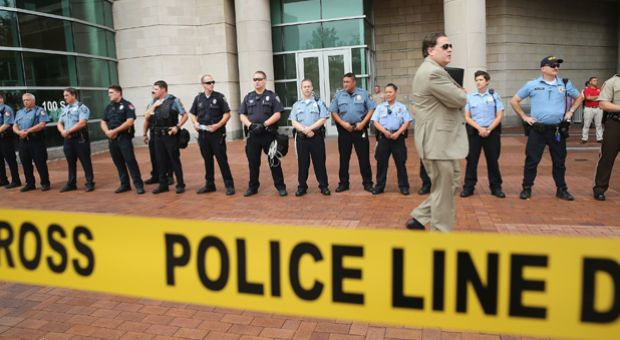 Police guard the front of the Buzz Westfall Justice Center where a grand jury will begin looking at the circumstances surrounding the fatal police shooting of an unarmed teenager Michael Brown on August 20, 2014 in Clayton, Missouri.
