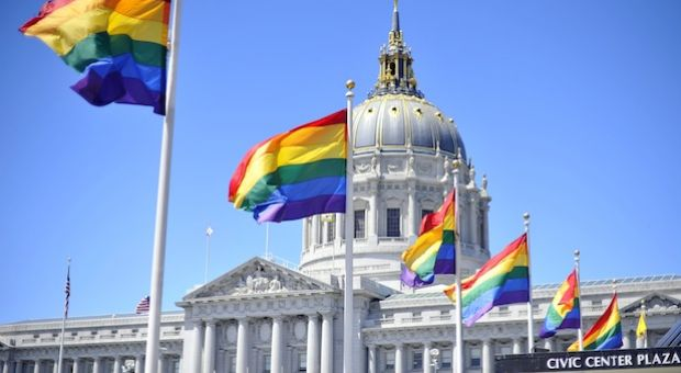 Rainbow flags line the courtyard at San Francisco's City Hall building on June 26, 2012.
