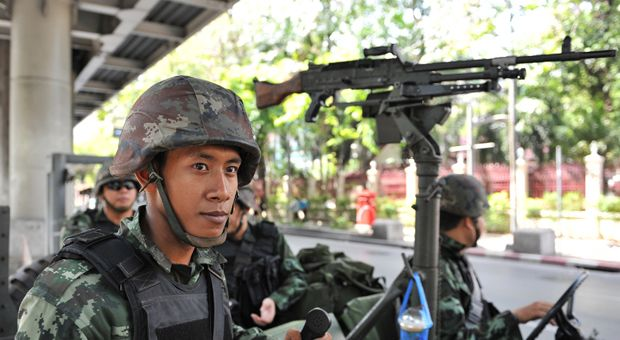 Thai army soldiers stand guard on a city street after martial law was declared on May 20, 2014 in Bangkok, Thailand. The army imposed martial law across Thailand amid a deepening political crisis that has seen six months of protests and claimed at least 28 lives.