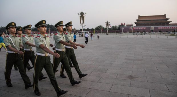 Chinese Paramilitary officers march in Tiananmen Square on June 3, 2014 in Beijing, China. Twenty-five years ago on June 4, 1989, Chinese troops cracked down on pro-democracy protesters.