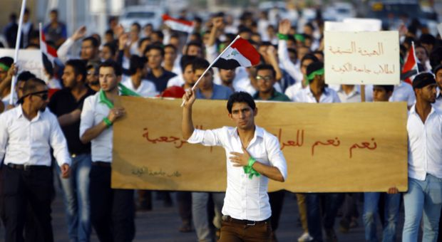 Iraqi men take part in a demonstration to show their support for the call to arms by Shiite cleric Grand Ayatollah Ali al-Sistani, in the central Shiite Muslim shrine city of Najaf on June 13, 2014. Sistani's call to defend the country against the offensive spearheaded by the jihadist Islamic State of Iraq and the Levant (ISIL) came as US President Barack Obama said he was exploring all options to save Iraq's security forces from collapse.