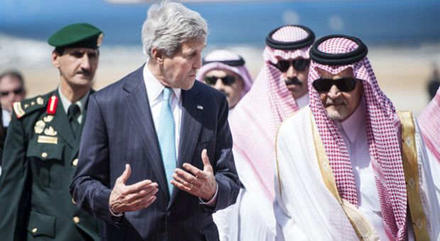 US Secretary of State John Kerry (L) and Saudi Foreign Minister Prince Saud al-Faisal (R) walk together upon Kerry's arrival on June 27, 2014 at King Abdulaziz International Airport in the Saudi city of Jeddah. Kerry arrived in Saudi Arabia to meet the Syrian opposition, a day after hosting urgent talks on Syria and Iraq in Paris, as Washington unveiled plans to provide some $500 million in arms and training to the Syrian rebels.