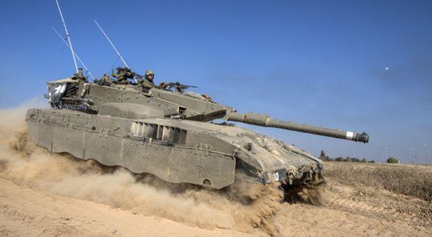 An Israeli Merkava tank rolls near the Israeli-Gaza Strip border, on July 21, 2014. US Secretary of State John Kerry is to push for an immediate ceasefire in Gaza when he arrives Monday in Cairo, President Barack Obama said.