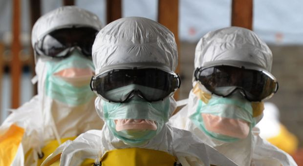 Health care workers, wearing protective suits, leave a high-risk area at the French NGO Medecins Sans Frontieres (Doctors without borders) Elwa hospital on August 30, 2014 in Monrovia. Liberia has been hardest-hit by the Ebola virus raging through west Africa, with 624 deaths and 1,082 cases since the start of the year.