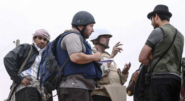 In this handout image made available by the photographer American journalist Steven Sotloff (Center with black helmet) talks to Libyan rebels on the Al Dafniya front line, 25 km west of Misrata on June 02, 2011 in Misrata, Libya. Sotloff was kidnapped in August 2013 near Aleppo, Syria. A video released Tuesday by ISIS claims to show Sotloff's execution.