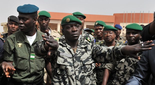 "Malian military junta leader Amadou Sanogo (C) arrives at Bamako airport on March 29, 2012 in Bamako. A bid by west African leaders to seek a return to democratic rule in Mali fell apart that week when the team turned back mid-air after a pro-coup demonstration in Bamako airport.  Todd Moss' new novel ""The Golden Hour"" fictionalizes a coup in Mali; weeks after Moss finished the novel's first draft in 2012, a real coup occurred in the country."