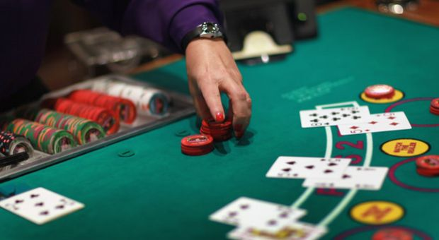 A dealer works the blackjack table during the grand opening of the newest building at the Seminole Casino Coconut Creek on December 17, 2010 in Coconut Creek, Florida.
