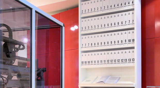 The first printout of the human genome to be presented as a series of books, displayed in the 'Medicine Now' room at the Wellcome Collection, London. The 3.4 billion units of DNA code are transcribed into more than a hundred volumes, each a thousand pages long, in type so small as to be barely legible.