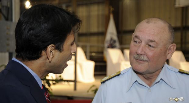 U.S. Coast Guard Commandant Adm. Thad Allen talks with Louisiana Gov. Bobby Jindal before a keel laying ceremony for the first Coast Guard Sentinel Class Fast Response Cutter at the Bollinger Shipyards, April 9, 2010 - just a week and a half before the Deepwater Horizon oil rig explosion.