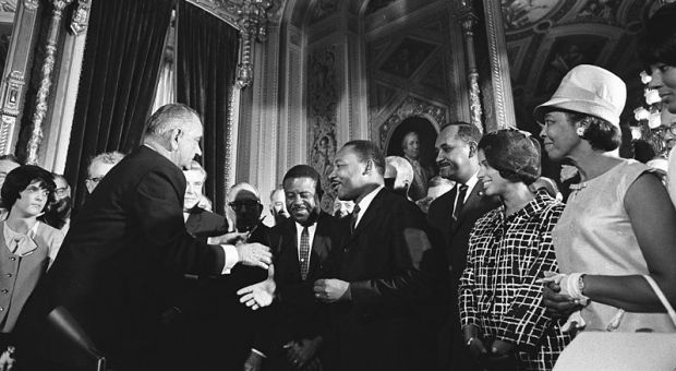 President Lyndon Johnson and Martin Luther King Jr. on August 6, 1965, the day President Johnson signed the Voting Rights Act