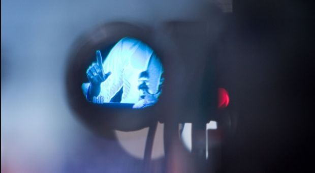 President Barack Obama is seen through the eyepiece of a video camera as he delivers remarks on health care reform at Arcadia University in Glenside, Pa., March 8, 2010.