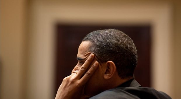 President Barack Obama listens during a meeting in the Roosevelt Room of the White House, March 11, 2010.