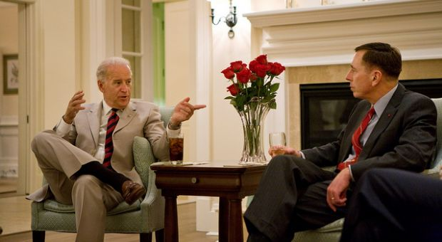 Vice President Joe Biden talks with Gen. David Petraeus, before dinner at the General's home at U.S. Central Command in Tampa, Fla., June 29